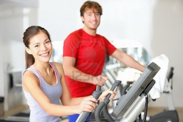 12611656-fitness-center-people-smiling-happy-working-out-on-moonwalker-fitness-machines-in-fitness-center-asi